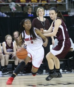 Holmes' Laila Johnson drives against Russell's Camryn Ratliff. (Photo by Jim Osborn)