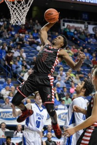 Taylor County's Quentin Goodin skies for 2 of his 28 points against Mason County. (Photo by Tim Webb)